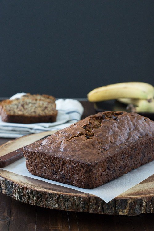 Easy Banana Chocolate Chip Bread loaf on a wooden board.