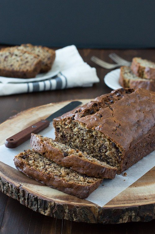 Easy Banana Chocolate Chip Bread sliced on a wooden board.