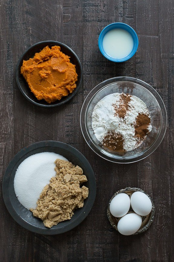 Starbucks Pumpkin Pound Cake ingredients in bowls on a wooden table.