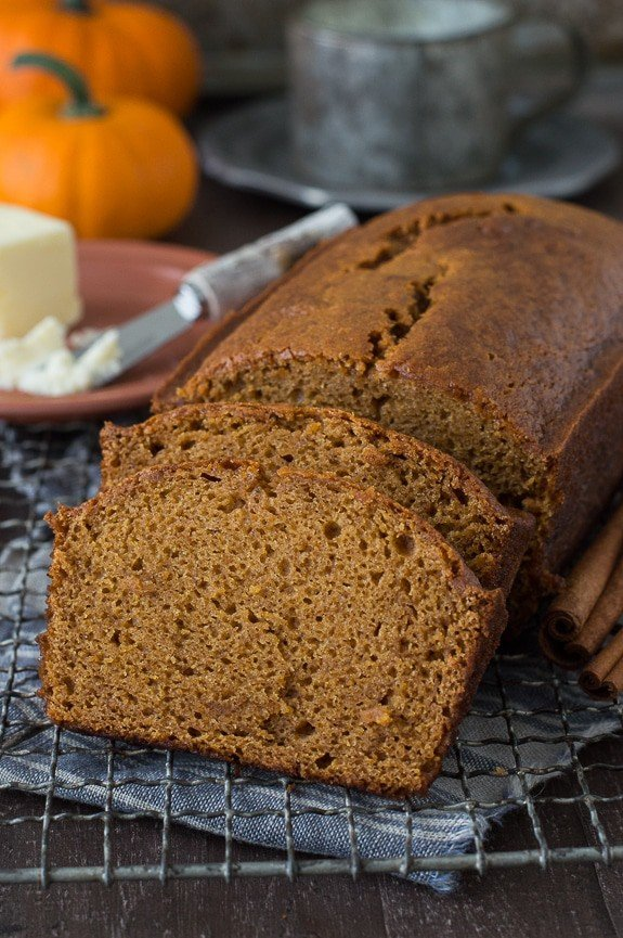 Two slices cut out of this delicious Starbucks Pumpkin Pound Cake recipe on a cooling rack.