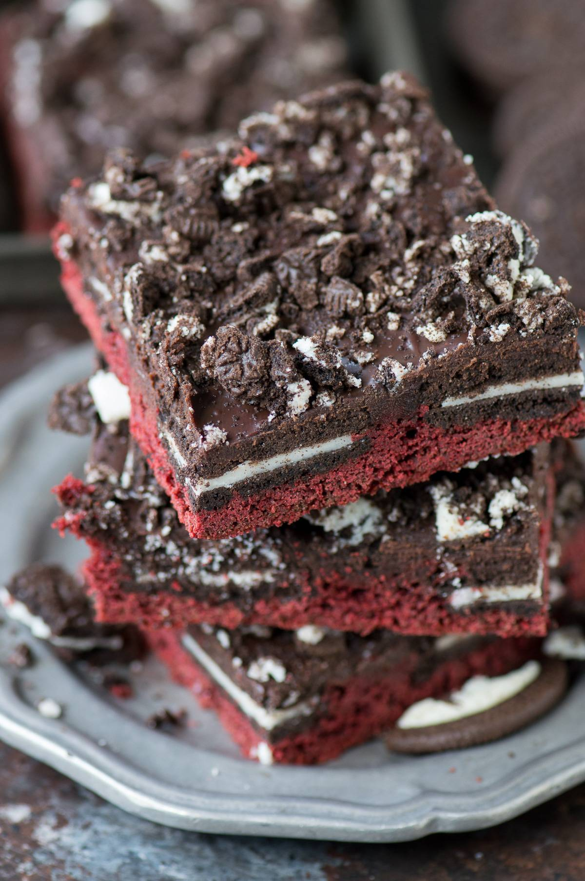 Quick red velvet stuffed oreo bars! The base of the batter starts with a box mix, then add oreos and melted chocolate.This is an easy red velvet Valentine's Day recipe!