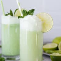 This is our favorite Lime Sherbet Float recipe because it calls for 2 secret ingredients that really make it taste AMAZING! Plus you can reuse this lime sherbet float recipe in the summertime or it would be fun to serve at a baby shower!