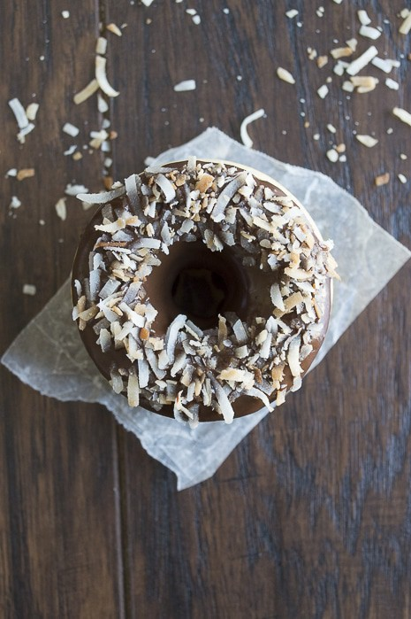 A coconut infused donut glazed with an easy to make chocolate ganache and topped with oven toasted coconut, takes only 10 minutes to bake!