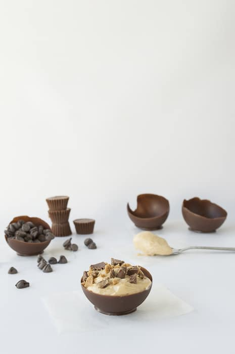 Chocolate Bowls with Peanut Butter Mousse, Peanut Butter Cup Crumbles and a Chocolate Dipped Pretzel | thefirstyearblog.com