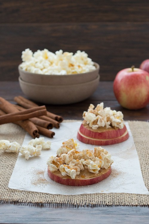 Make this your healthy go-to snack! Made with apples, peanut butter, popcorn, a sprinkle of cinnamon sugar and a drizzle of caramel.