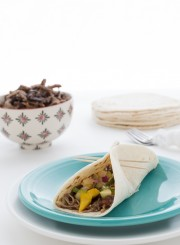 Cook this meal in the crock pot for 5 hours and you'll have the BEST chicken and black bean taco meat. Serve on tortillas and top with a crisp mango green apple salsa.