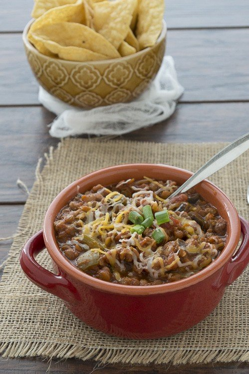 This healthy vegetarian chili only takes 10 minutes to prep and 1 hour to simmer in the crock pot. It's very adaptable so add your favorite vegetables!