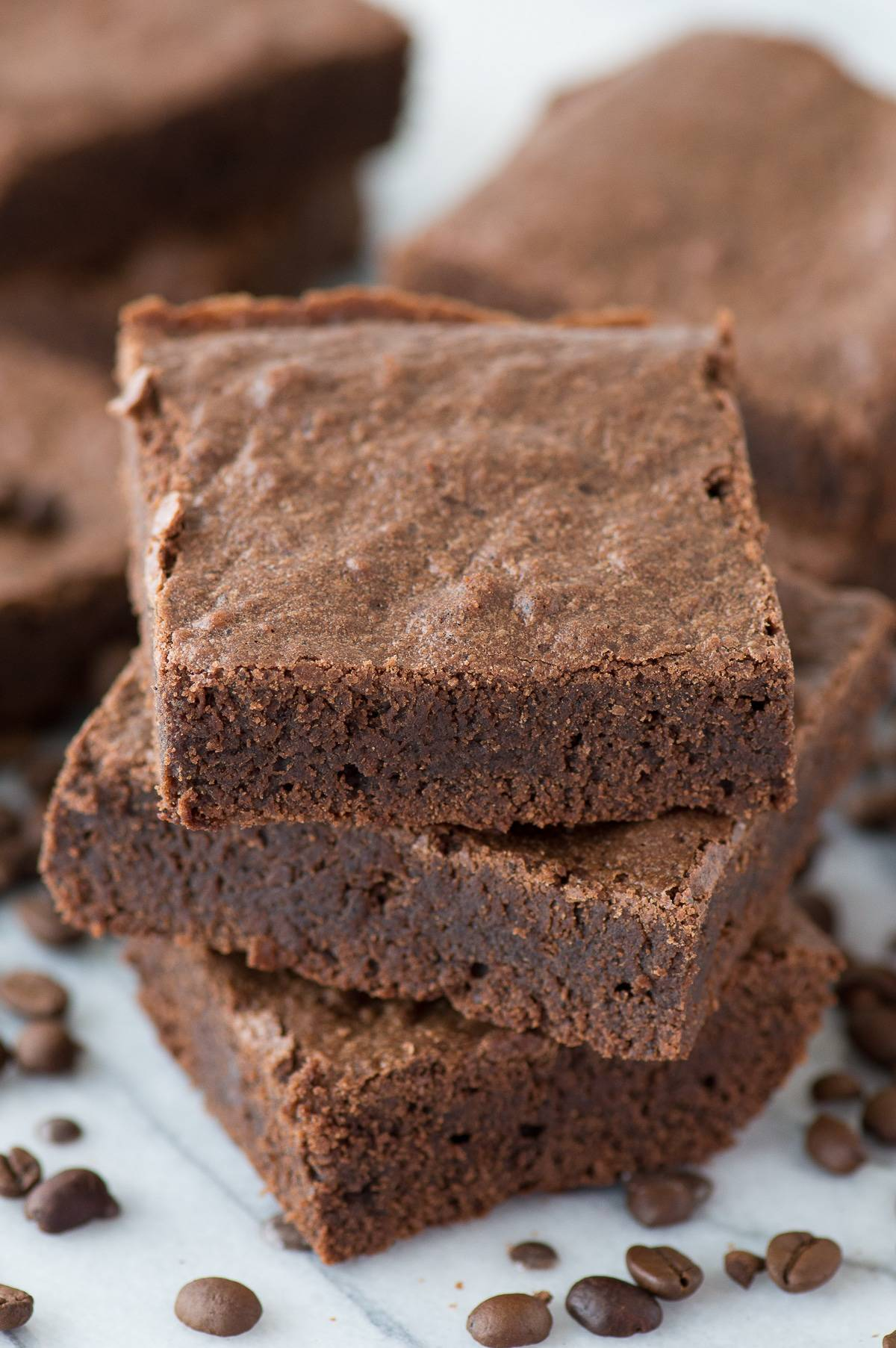 The best espresso brownies with real espresso grounds! Fudgy and dense, adaptable recipe for a small or large pan!