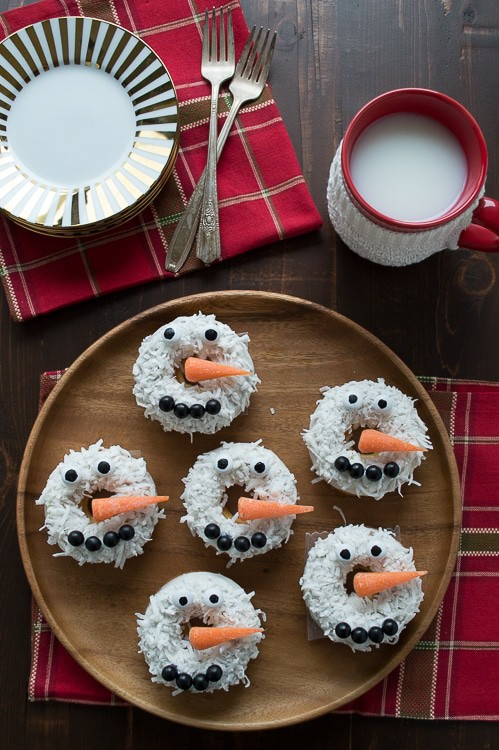 Baked caramel coconut donuts all dressed up to look like snowmen! These are SO adorable and easy to put together!!