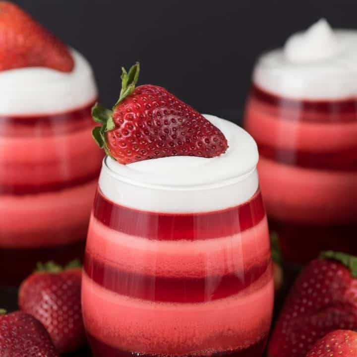 Layered Strawberry Jello Cups - the most popular jello cups on pinterest! You have to see these!