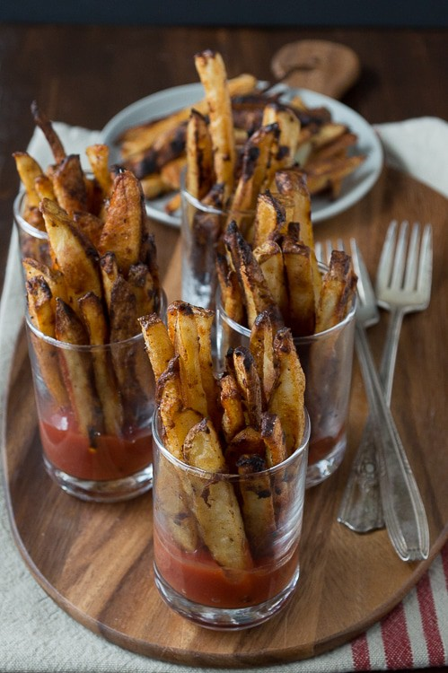 Spicy Dijon French Fries - this recipe for homemade french fries is easy and only takes 35 minutes to bake! Serve them in mini glasses with ketchup.