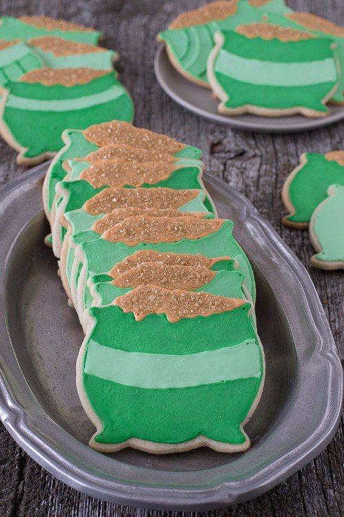 Nine St. Patrick's Day Cookies on a silver platter.