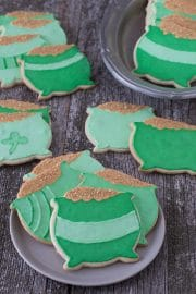 Three easy Pot o' Gold Cookies on a small serving plate.
