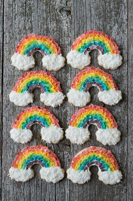 S closeup of Eight Rainbow Sugar Cookies with fruity pebbles and shredded coconut to make a delicious rainbow cookies recipe.