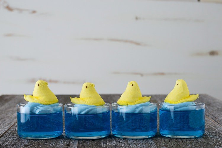 blue jello in glass bowl with yellow peep on top, 4 in a row