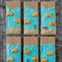 Six delicious and easy Under the Sea Graham Crackers on a wooden table.