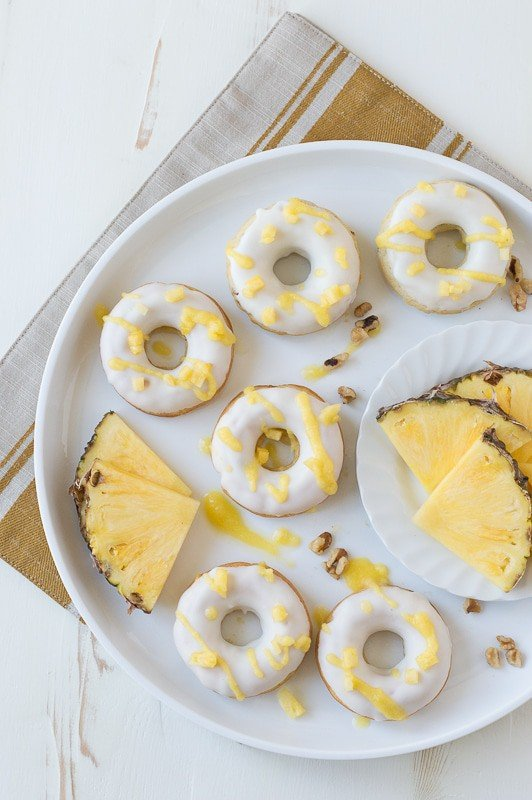 Pineapple Walnut Donuts with a white chocolate glaze and pineapple puree drizzle!