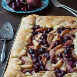 Cherry Peach Slab Pie - an easy open face pie made on a baking sheet! The crust is amazing!