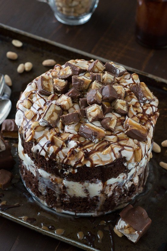 Snickers Bar Ice Cream Cake with actual Snickers ice cream bars inside the cake! This cake is LOADED!