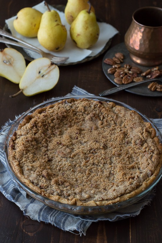 This homemade pear pie is perfect! Topped with a pecan streusel and full of fresh pears, use either homemade or store bought pie dough.