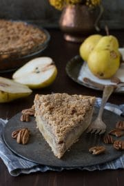This homemade pear pie is perfect! Topped with a pecan streusel and full of fresh pears, you use homemade or store bough pie dough.
