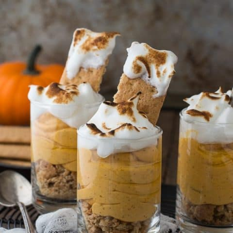 Pumpkin pie cheesecake shooters topped with toasted meringue!