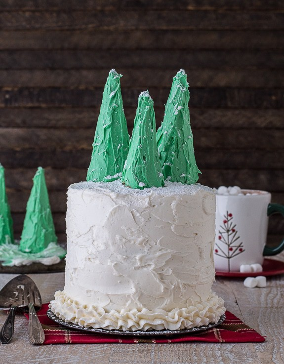 Easy gingerbread cake with vanilla bean buttercream, topped with snowy christmas trees!