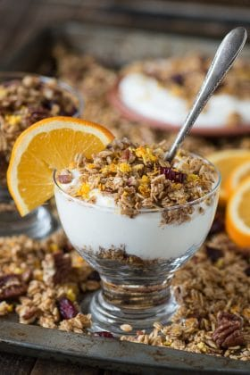 Homemade orange cranberry granola with orange zest, pecans, and dried cranberries! A soft granola that bakes in 8 minutes!