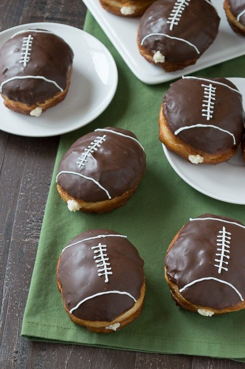 Cream Filled Chocolate Football Donuts on White Serving Plates | The First Year