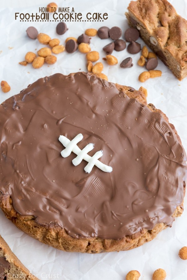 Football Cookie Cake Surrounded by Chocolate Chips and Peanuts | Crazy For Crust