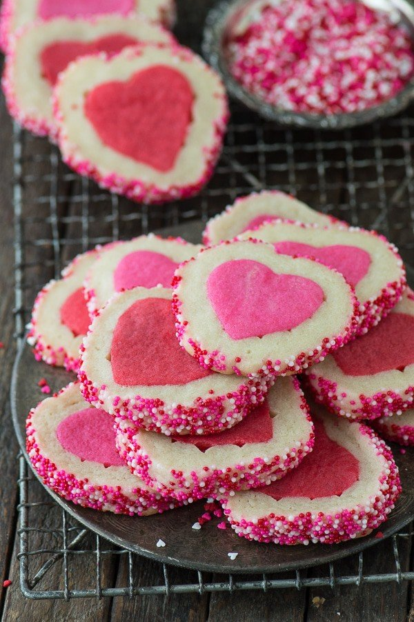 A stack of pink and white Homemade Valentine's Day Slice N' Bake Cookies on a cooling rack.