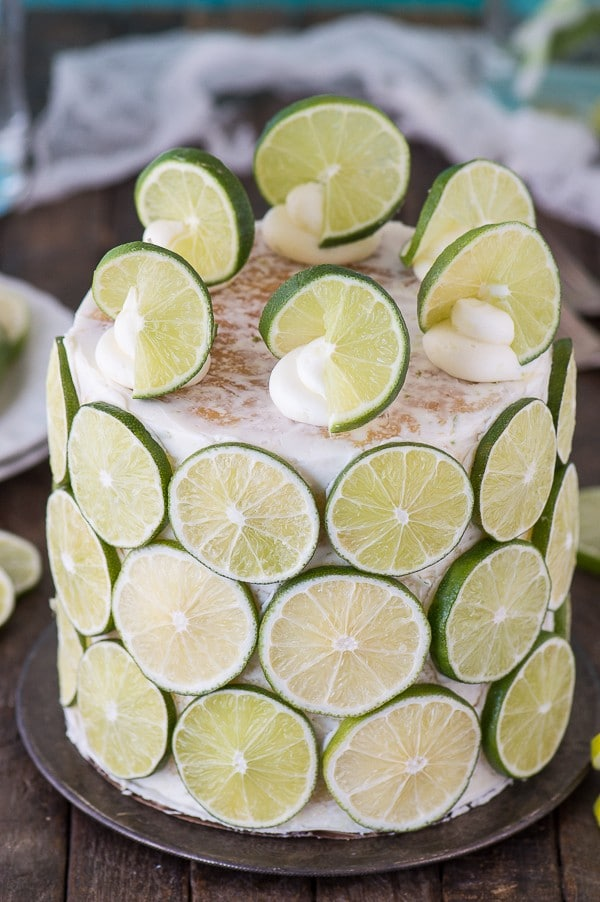 The best coconut lime cake! Coconut cake paired with fresh lime buttercream, cover the cake in lime slices for a fun presentation!