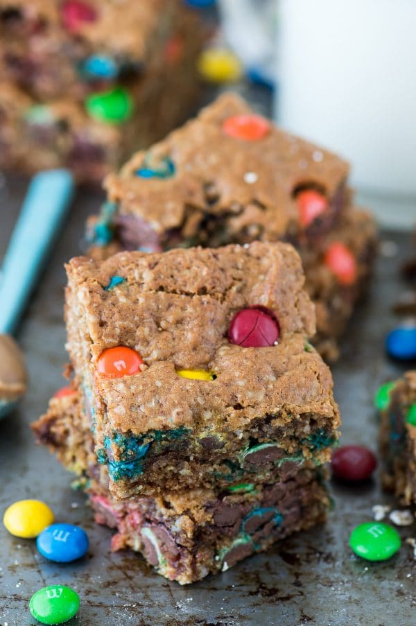 The BEST healthier monster cookie bars with no oil, butter, flour or sugar! Use coconut sugar or honey instead! Makes an 8x8 square pan so you don't have too many around!