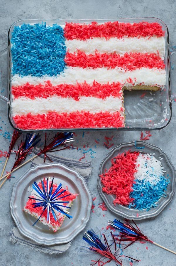 4th of july cake topped with red, white and blue shredded coconut in a flag pattern