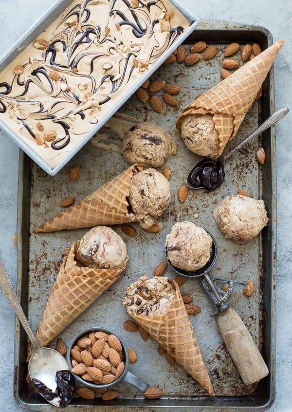 No churn mocha almond fudge ice cream! Incredibly easy coffee ice cream recipe loaded with almonds and hot fudge swirls!