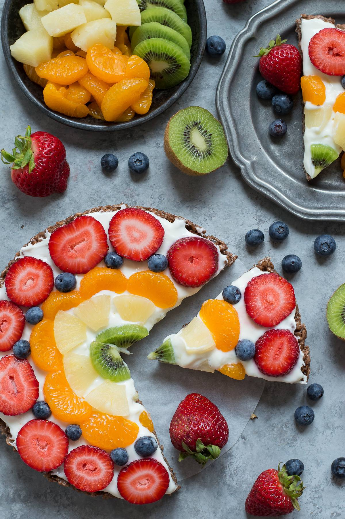 A fun twist on a fruit tart, featuring a chocolate crispy cereal treat crust and all your favorite fruit!