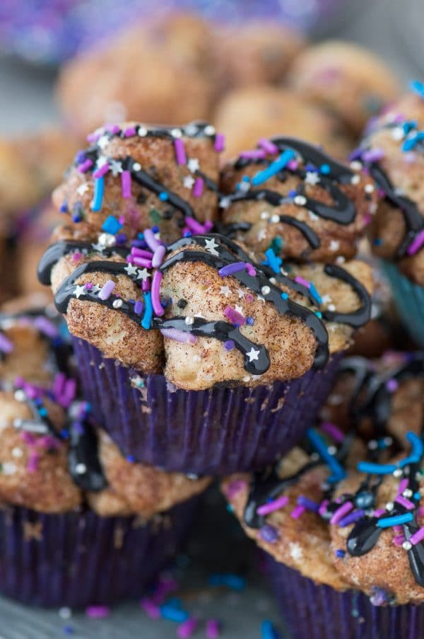 Galaxy Monkey Bread Muffins! Monkey bread turned into muffins with galaxy sprinkles and black cream cheese glaze! These are out of this world!