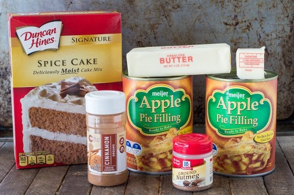 ingredients to make apple dump cake on brown background