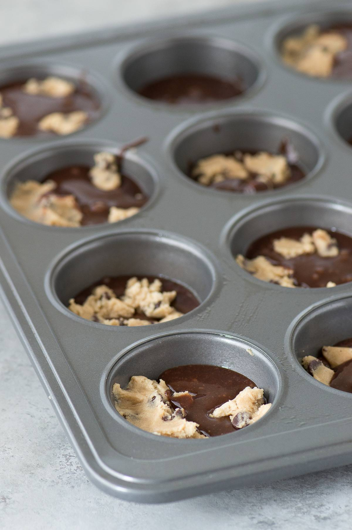 The easiest brookie cups recipe! It's a brownie and a cookie baked in a muffin pan - the best combination ever!