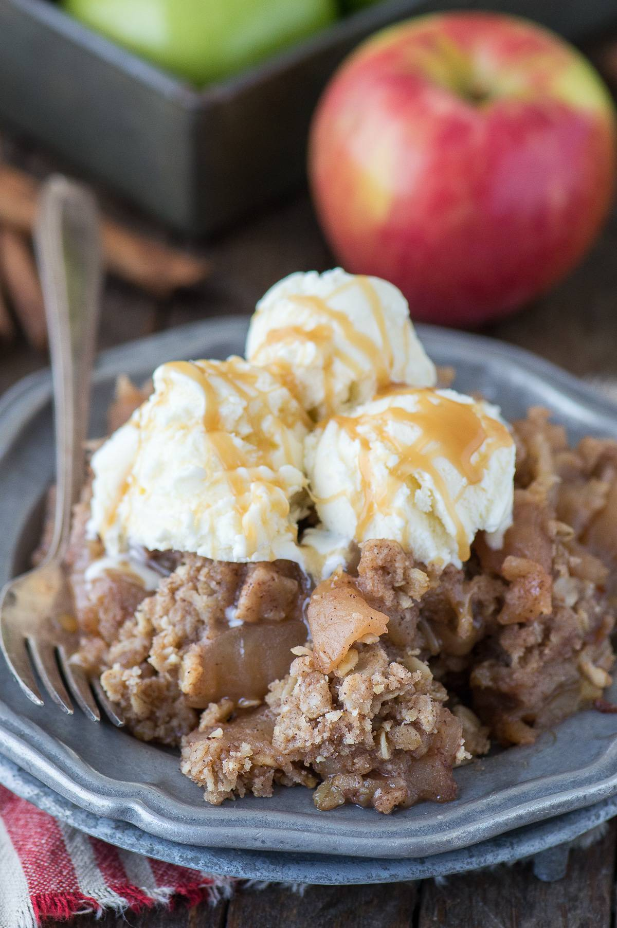The best crock pot apple crisp! The apples are tender and full of cinnamon flavor - the oat topping is soft and sweet. This is our favorite crisp recipe and plus it smells amazing while it's cooking!