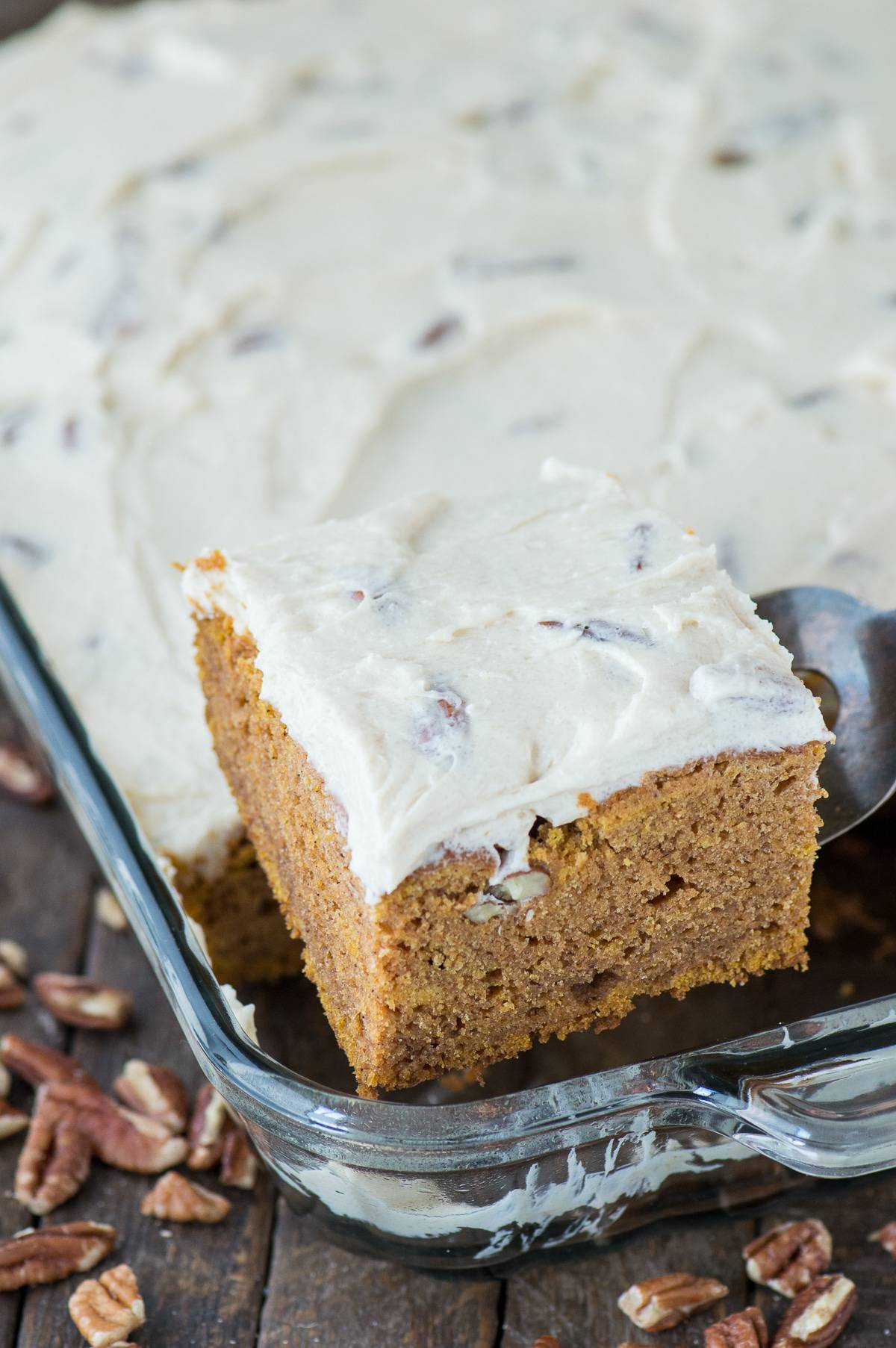 Easy to make pumpkin sheet cake made in a 9x13 inch pan with homemade butter pecan frosting!