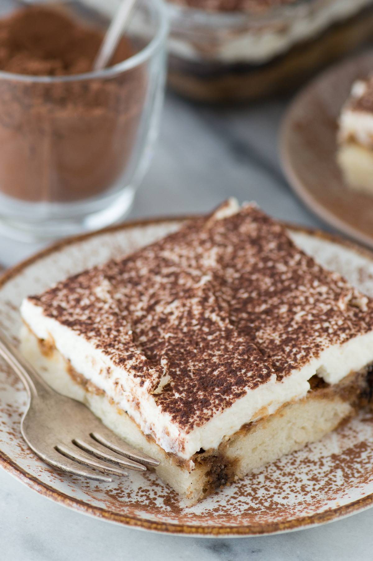 A 9x13 inch tiramisu cake recipe with an eggless frosting alternative!