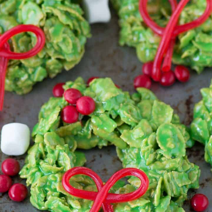No bake christmas wreath cookies made with corn flakes and marshmallows! These only take 20 minutes to make!