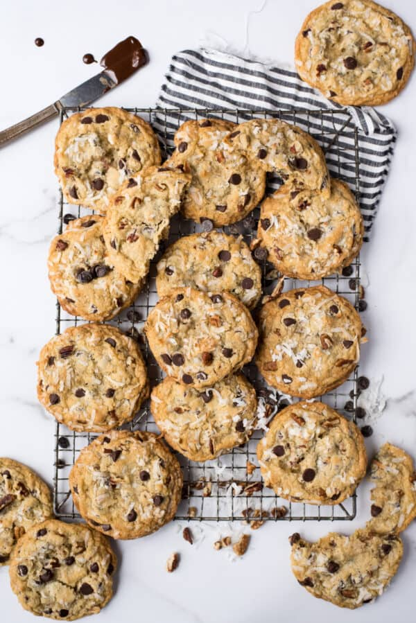 cowboy cookies on wire rack on white marble background