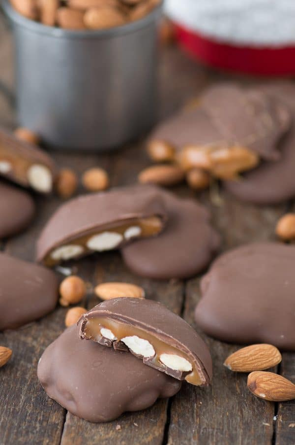 Five Sticky Paws Williams Sonoma Copycat on a wooden table surrounded by almonds.