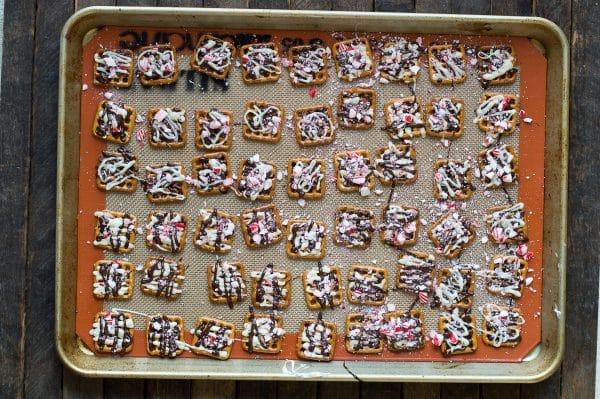 peppermint bark pretzels arranged on metal baking sheet