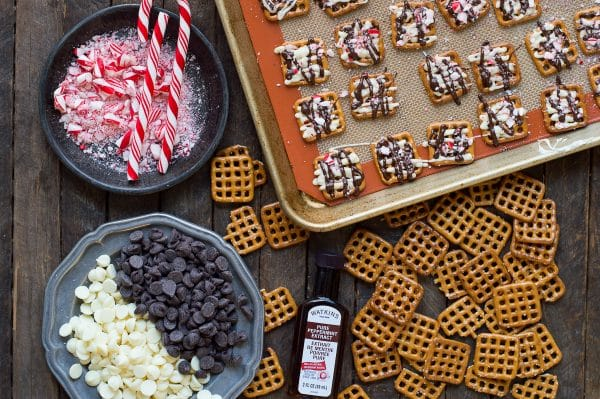 ingredients to make peppermint bark pretzels on wood background