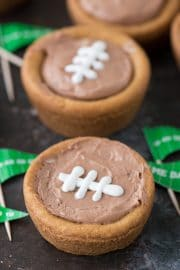 game day flags with cheesecake sugar cookie football cups