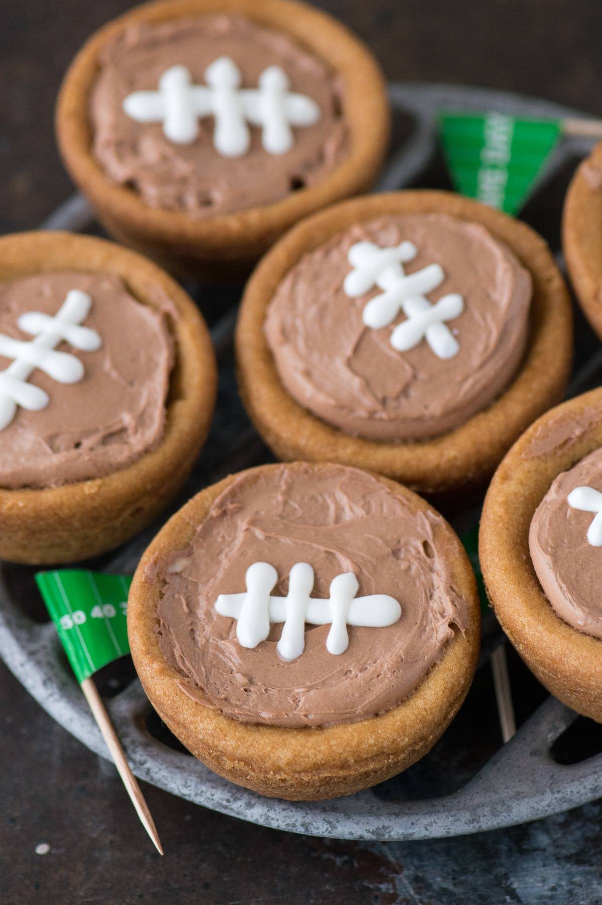 cheesecake sugar cookie football cups on a serving dish with Game Day flags