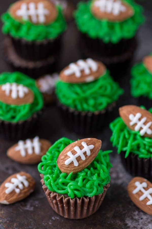 Reese's Peanut Butter Football Cups with Green Grass Frosting